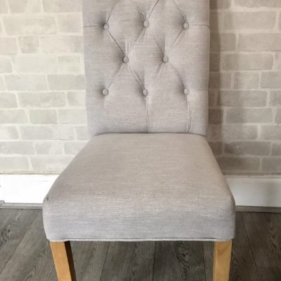 Fabric button back dining chairs with oak legs main sand
